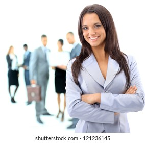 Portrrait of a young business woman with people discussing in background