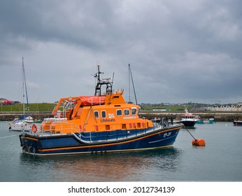 Portrush, UK - Jun 22 2021: The Severn Class RNLB Roger and Joy Freeman relief lifeboat moored in Portrush Harbour, Northern Ireland, UK