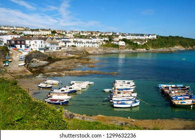 Portscatho, UK - 25th July 2017: View of the harbour and coastline at Portscatho, Cornwall, UK on a beautiful summer morning. Portscatho is a popular family seaside holiday destination.