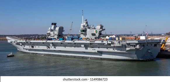 Portsmouth. England. 06.29.18. HMS Queen Elizabeth - Royal Navy - United Kingdom. Capable of carrying up to 60 aircraft and is designed to operate V/STOL aircraft and Merlin Helicopters.