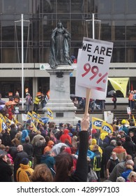 "Portsmouth, England, 30th November 2011, Protesters against austerity gather for a rally whilst a placard proclaiming ""We are 99%"" is held high"