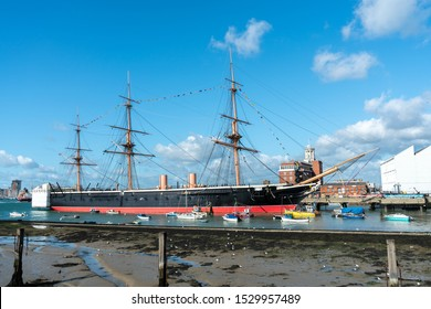 PORTSMOUTH, ENGLAND - 6 October 2019: Portsmouth Historic Dockyard with HMS Warrior Warship built in 1860 in Portsmouth harbour, England.