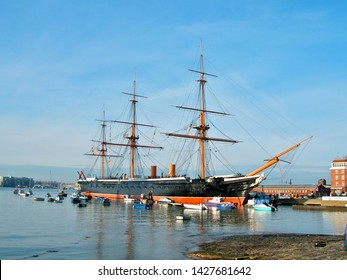 PORTSMOUTH, ENGLAND - JUNE 5. The Portsmouth Historic Dockyard contains HMS Warrior, a warship built in 1860, on June 5, 2015, Portsmouth, England.