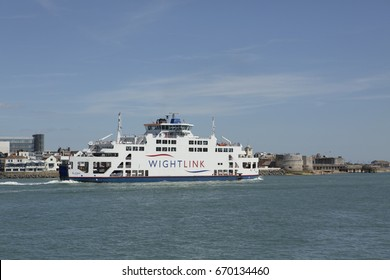 PORTSMOUTH ENGLAND UK; JULY 2nd 2017. Wightlink car ferry St Clare leaving Portsmouth Harbour. Spice Island and round tower in the background.