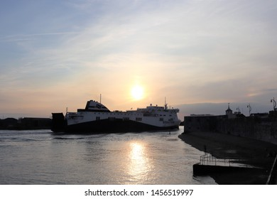 Portsmouth, Hampshire, England - July 13th 2019: Brittany Ferries vessel Etretat passing Old Portsmouth fortifications and entering Portsmouth Harbour at sunset.