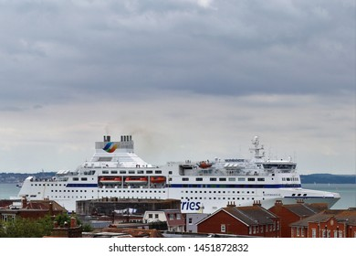 Portsmouth, Hampshire, England - July 14th 2019: Roof tops view of Brittany Ferries vessel Normandie steaming past Old Portsmouth, inbound to Portsmouth Port from Oustreham, Normandy.