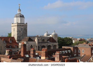 Portsmouth, Hampshire, England - July 14th 2019: Elevated view of Portsmouth Anglican Cathedral  with adjacent  music rooms and Old Portsmouth architecture.