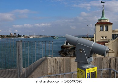Portsmouth, Hampshire, England - July 14th2019: Telescope at the viewing platform on The Round Tower, Old Portsmouth, looking across Portsmouth Harbour towards Gosport.