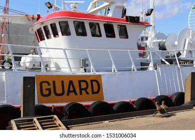 Portsmouth, Hampshire, England - September 4th 2019: Guard Vessel Sharon Vale moored at the Camber Dock, Old Portsmouth. View of wheel house area with high visibility sign marked Guard on hull side.