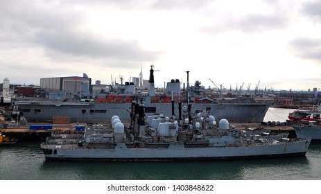 Portsmouth, Hampshire / UK - 09/22/2010: Decommissioned warships, with 1978 Type 42 destroyer HMS 'Exeter' in foreground.