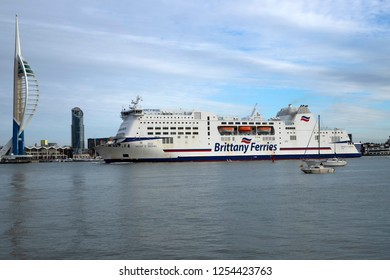 Portsmouth, Hampshire, UK December 10 2018 Brittany Ferries car ferry Mont St Michel arriving from Ouistreham, France with the Spinnaker Tower to the left of the image