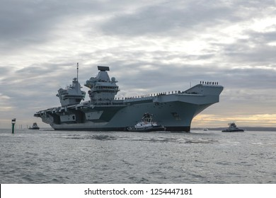 PORTSMOUTH HAMPSHIRE UK; DECEMBER 10th 2018. HMS Queen Elizabeth arrives in its home port of Portsmouth for Christmas after flight training is the USA. Crew line the decks at procedure alpha.