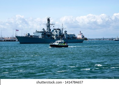 Portsmouth, Hampshire, UK June 3 2019  Royal Navy frigate HMS St Albans leaving port escorting MV Mont St Michel who is carrying D-Day veterans to Normandy for the 75th anniversary commemorations