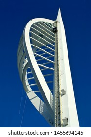 Portsmouth, Hampshire/UK - 7/29/2005: The white curving structure of Spinnaker tower reaches up into deep blue sky. replicating a ship's sail.