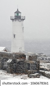 Portsmouth Harbor lighthouse during a blizzard snowstorm in New Hampshire.