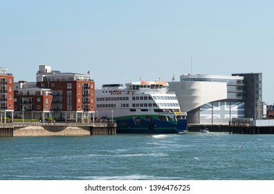 Portsmouth Harbour, England, UK. May 2019. The roro ferry Victoria of Wight passing the Ben Ainslie Racing HQ building as it leaves The Camber