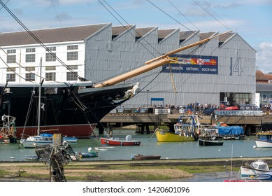 Portsmouth Harbour, England, UK, May 2019. The bow of HMS Warrior at the entrance to Portsmouth Historic Dockyard.