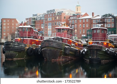 PORTSMOUTH - JANUARY 19:Tugboats in Portsmouth harbor,NH on january 19,2014. Their engines typically produce 680 to 3,400hp, but larger boats (used in deep waters) can have power ratings up to 27200hp