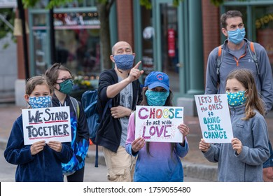 Portsmouth, New Hampshire (USA) - June 7th, 2020).  Thousands gathered at Market Square to request justice for George Floyd. Young girls holding signs