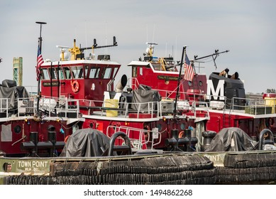 PORTSMOUTH, NH - FEBRUARY 25, 2016: Tugboats in Portsmouth harbor, NH Their engines typically produce 680 to 3,400hp, but larger boats used in deep waters can have power ratings up to 27200hp.