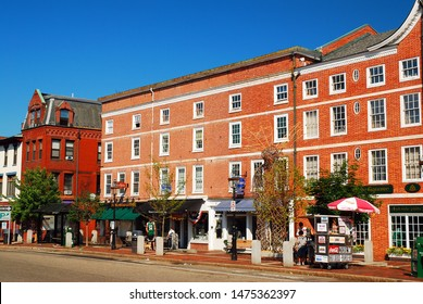 Portsmouth, NH, USA July 17 Historic Brick buildings house boutique shops and line the main street of Portsmouth New Hampshire