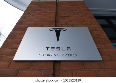 Portsmouth, N.H./USA - March 23, 2018. A sign for a Tesla electric car charging station posted at a hotel in this colonial port city in New England.