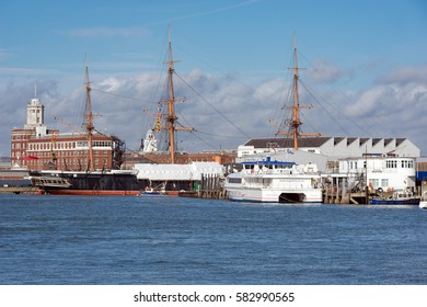 Portsmouth, UK. 16th February 2017. A view of Portsmouth Harbour towards Portsmouth Harbour station with the tall masts of HMS Victory visble.