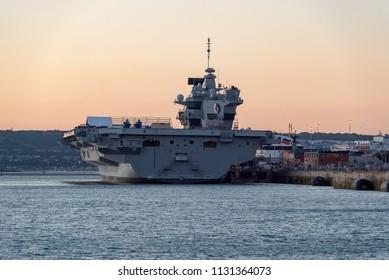 Portsmouth, UK. 1st July 2018. HMS Queen Elizabeth, Britain's biggest ever warship on the Portsmouth harbour skyline captured at sundown.