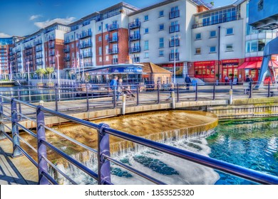 Portsmouth, UK. 24th March 2019. Portsmouth's waterfront destination entitled Gunwharf Quays on a warm sunny spring afternoon.