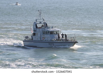 PORTSMOUTH, UK – 26TH SEP 2018: The Royal Navy Archer Class P2000 Fast Training Boat HMS PURSUER returning to harbour on completion of the 1st Patrol Boat Squadron annual exercise in the Solent