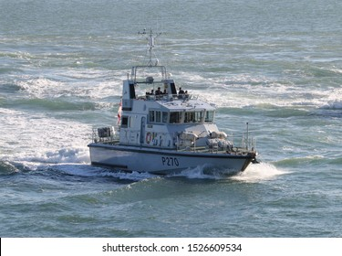 PORTSMOUTH, UK – 26TH SEP 2018: The Royal Navy Archer Class P2000 Fast Training Boat HMS BITER returning to harbour on completion of the 1st Patrol Boat Squadron annual exercise in the Solent