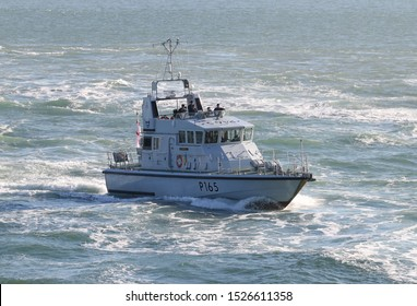 PORTSMOUTH, UK – 26TH SEP 2018: The Royal Navy Archer Class P2000 Fast Training Boat HMS EXAMPLE returning to harbour on completion of the 1st Patrol Boat Squadron annual exercise in the Solent