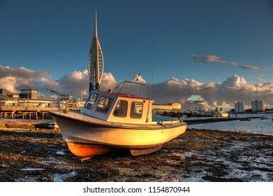 PORTSMOUTH, UK - AUGUST 10, 2018: Portsmouth harbour during sunset with small boat and spinnaker tower in the background. HDR style image