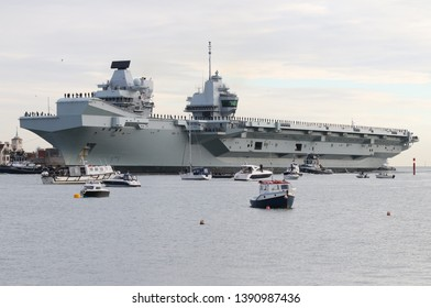 PORTSMOUTH, UK – DEC 10TH 2018: The Royal Navy aircraft carrier HMS QUEEN ELIZABETH returns home after trials involving F35 fighter aircraft off the west coast of America