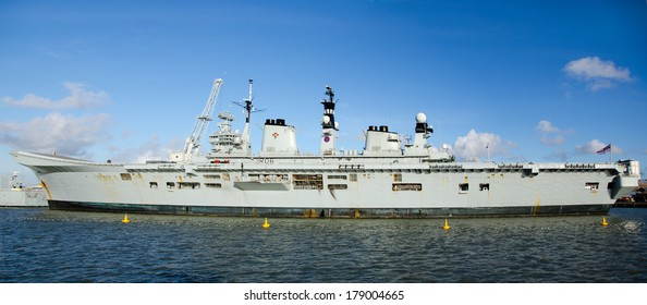 PORTSMOUTH, UK - FEB 22, 2014:  HMS Illustrious (RO6).  Formerly an aircraft carrier and now deployed as a helicopter carrier.  Illustrious is due for retirement this year.