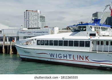 Portsmouth, UK - September 8, 2020: One of the Wightlink passenger catamaran ferries docked at the Portsmouth Harbour terminal on a sunny afternoon on the south coast of Hampshire.