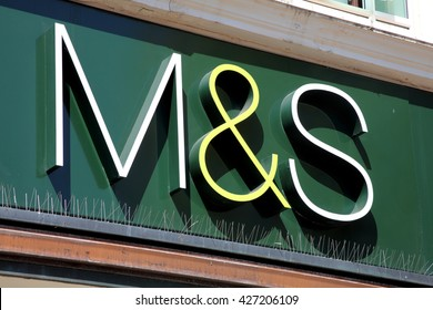 Portsmouth, United Kingdom, April 22, 2011 : Marks & Spencer  logo advertising sign outside one of its retail supermarket stores in Portsmouth city centre
