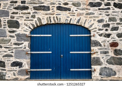 Portsoy, Aberdeenshire, Scotland, UK - June 16, 2018: Blue door on stone house at Old Harbourside Portsoy Aberdeenshire Scotland UK