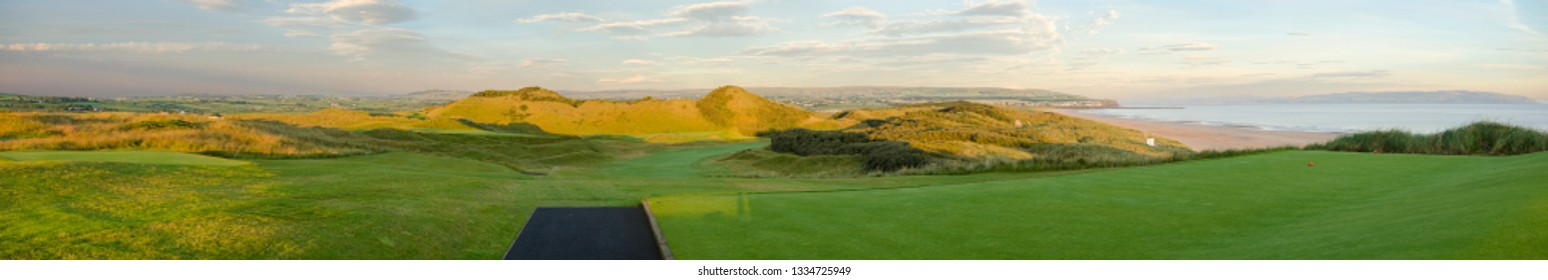 Portstewart Co.Londonderry Northern Ireland.  July 18th 2014. View of 1st Tee at Portstewart Golf Club with Portstewart strand and Mussenden Temple in the background.
