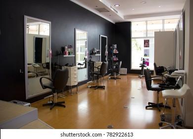 Portugal, Algarve, Lagoa. Circa 25.05.2013 Empty modern Victor Picado hair salon with chairs and mirrors.