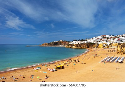 Portugal. Algarve. Old town Albufeira and sandy city beaches. People sunbathe and rest near the sea