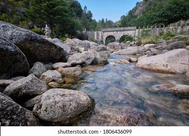 Gerês, Portugal - August 30, 2020 : Arado bridge in the mountains Peneda-Geres National Park, Gerês, Portugal