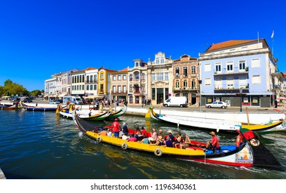PORTUGAL, AVEIRO - SEP 29, 2018: View of the Sao Roque canal with old buildings and boats (gondolas) on the canal in beautiful blue sky summer day.