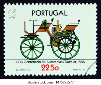 """PORTUGAL - CIRCA 1986: A stamp printed in Portugal from the """"100th Anniversary of the Automobile"""" issue shows Daimler Motor Car, 1886, circa 1986."""