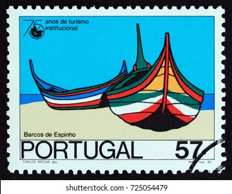 "PORTUGAL - CIRCA 1987: A stamp printed in Portugal from the ""75th anniversary of Organized Tourism"" issue shows Fishing boats, Espinho, circa 1987."