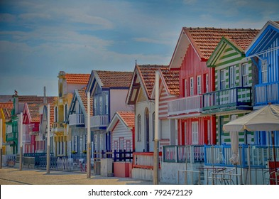 Portugal, Costa Nova. Fisherman's village with striped, decorated houses, which line the main promenade. Located on a spit of land linked to mainland Portugal by a bridge, about 11km west of Aveiro.