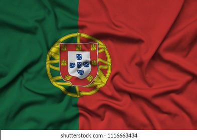 Portugal flag  is depicted on a sports cloth fabric with many folds. Sport team banner