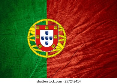 Portugal flag or Portuguese banner on wooden texture