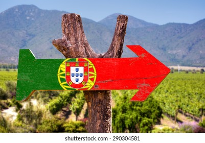 Portugal Flag wooden sign with winery background