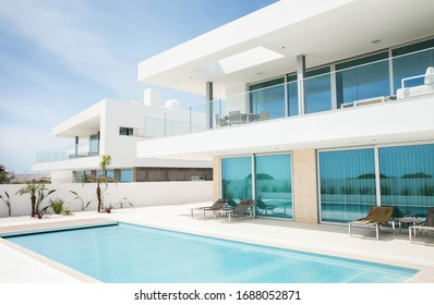 Portugal, Lagos, 05 April 2018 - illustrative editorial. White villa, cottage, luxury house for recreation with swimming pool, terrace with a view, balcony, modern design.